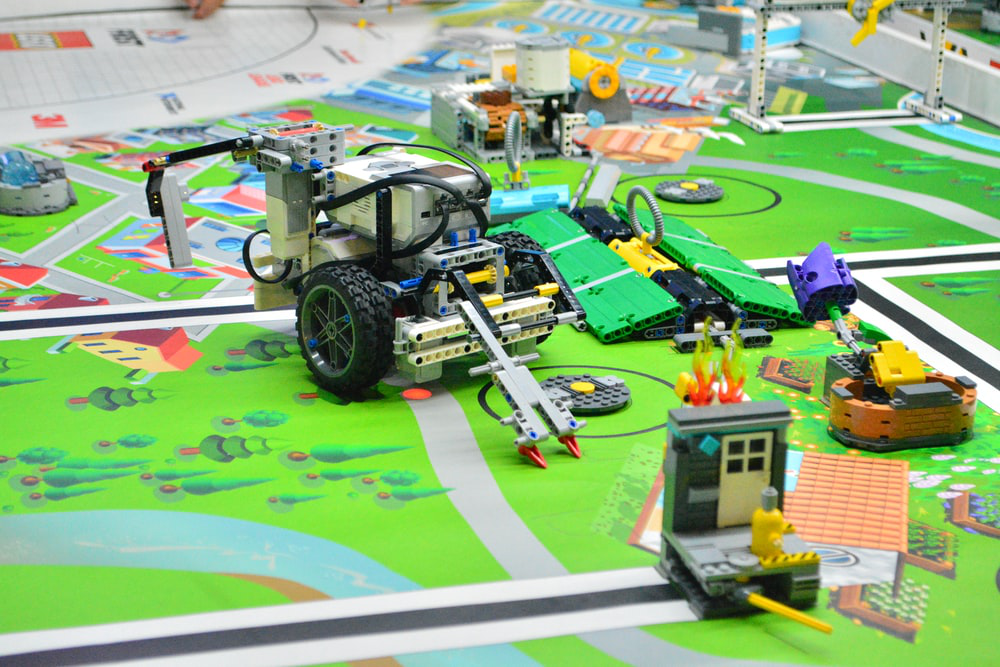 A remote control lego toy car build by students using the concepts of robotics and AI
