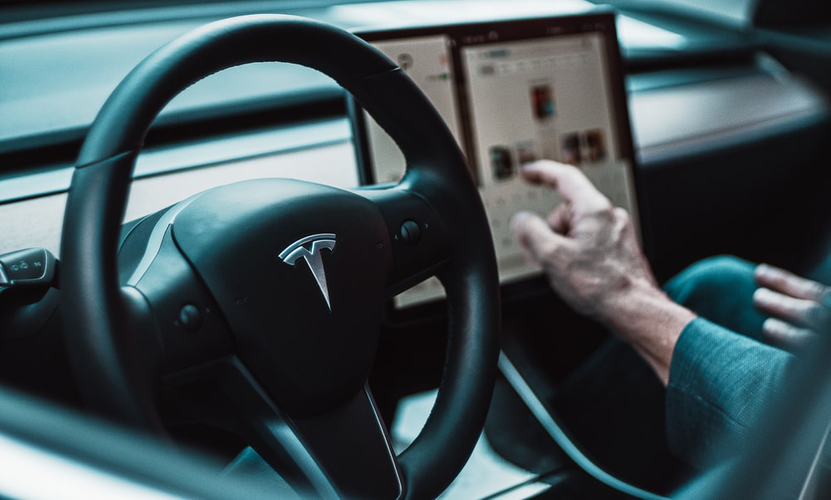 Interior of a self-driving Tesla, which represents the advancements in AI technology