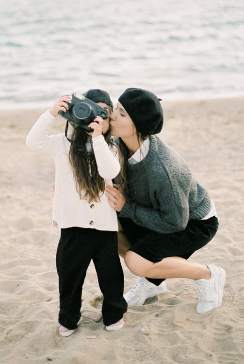 A child taking pictures at the beach