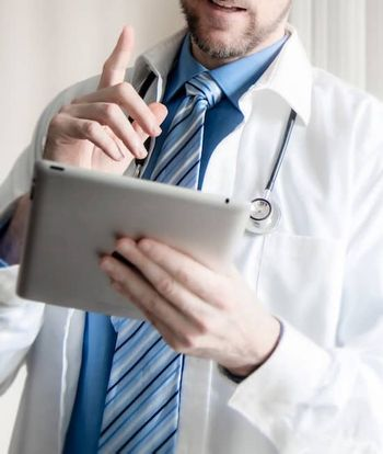 doctor-using-computer-tablet-to-consult-with-patient.jpg