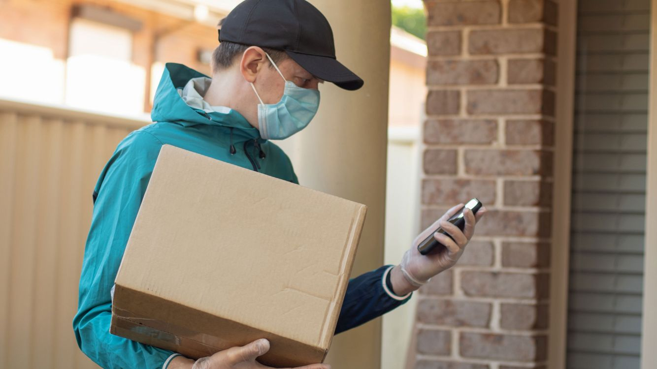pharmacy-delivery-man-with-box-iStock-1219082613.jpg