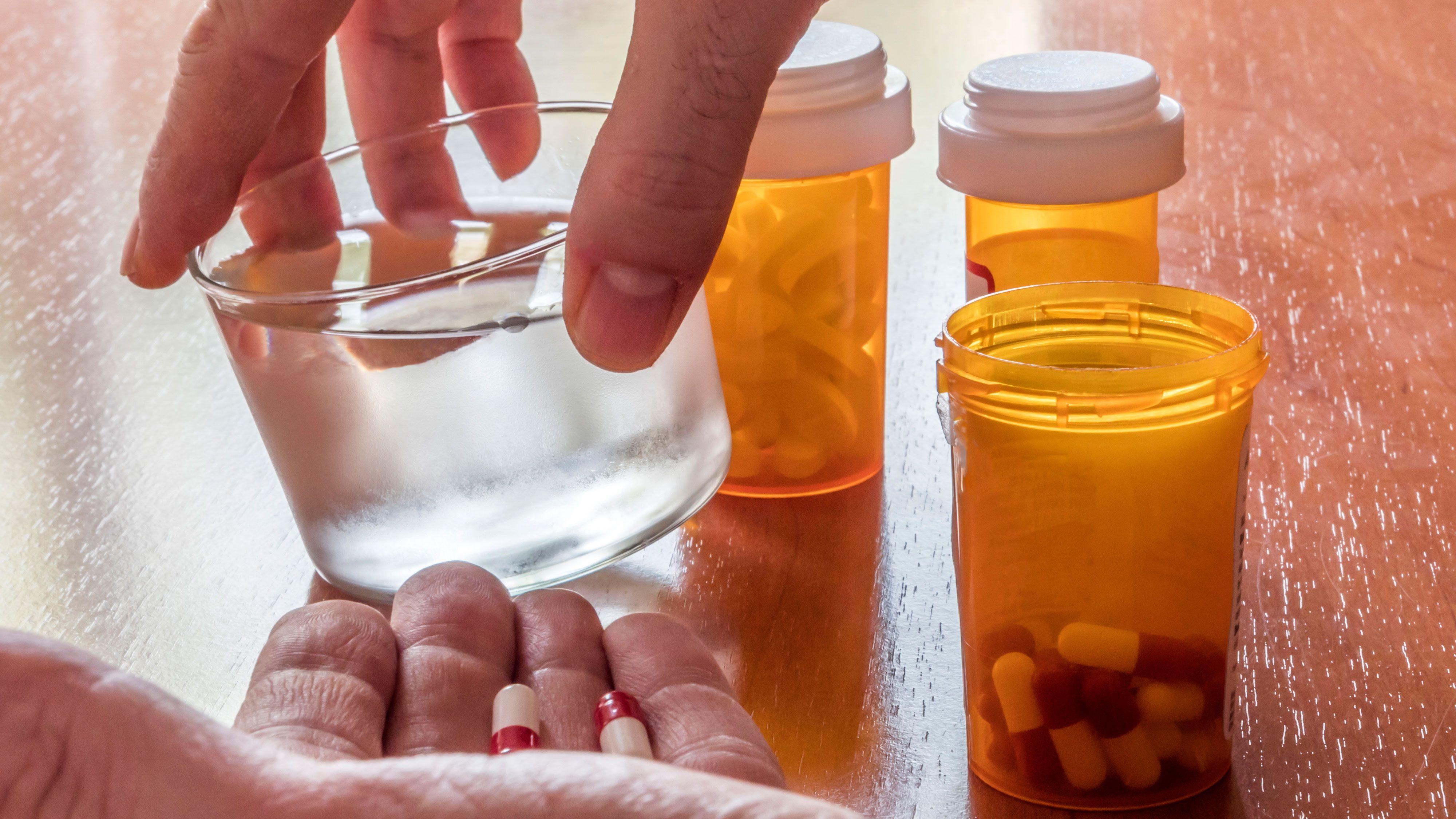 pharmacy-pills-in-hand-iStock-1086688144.jpg