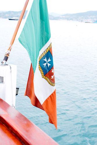 italian flag off a boat in portovenere