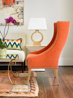orange chair and woven rug.jpg