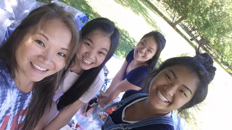 Chris and her daughters enjoying a day at the park.