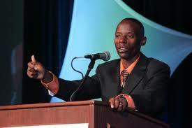 Gilbert Tuhabonye speaking at an inspirational event