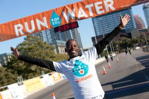 Gilbert Tuhabonye of Burundi, Africa, at the finish line of Run for the Water