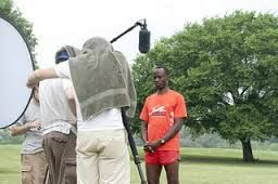 Gilbert Tuhabonye filming for Gilbert's Gazelles
