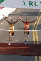 Gilbert Tuhabonye wins a race