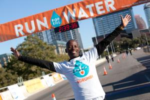 Gilbert Tuhabonye of Burundi, Africa, at the finish line of Run for the Water