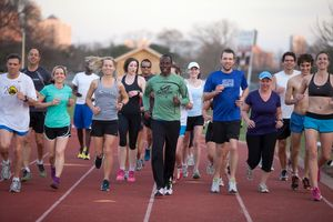 Gilbert Tuhabonye with Desiree Ficker and other Gilbert's Gazelles in Austin, TX