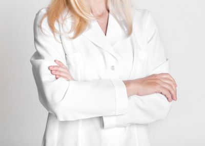 female-doctor-in-white-uniform-with-crossed-arms-HJQPNJM.jpg