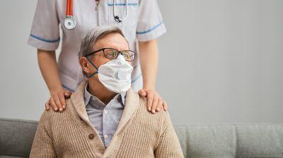 doctor-and-senior-man-wearing-facemasks-WHEYLVG.jpg