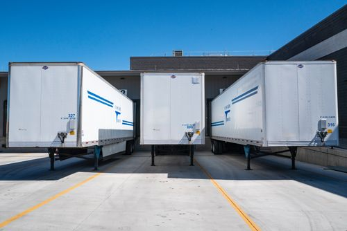 three-white-enclosed-trailers-1267325.jpg