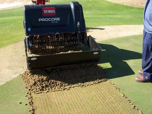 turf_pride_core-collector-on-toro-dumping-cores.jpg