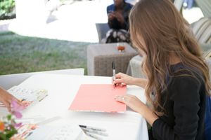 Camille Styles signing her book