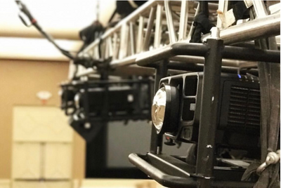 Projector rigged onto a truss