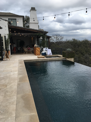 Camille Styles' patio with pool and bistro lights