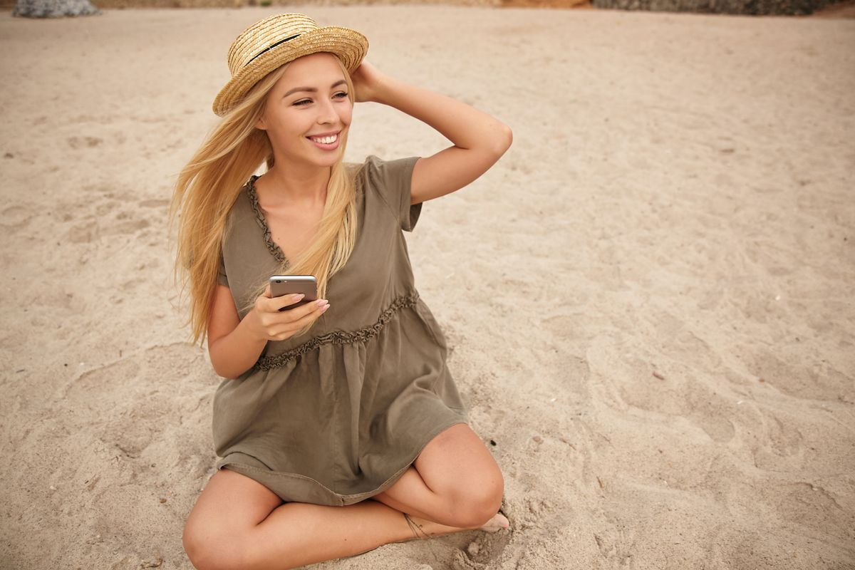 outdoor-photo-of-charming-young-female-with-blonde-ASYQCVN.jpg