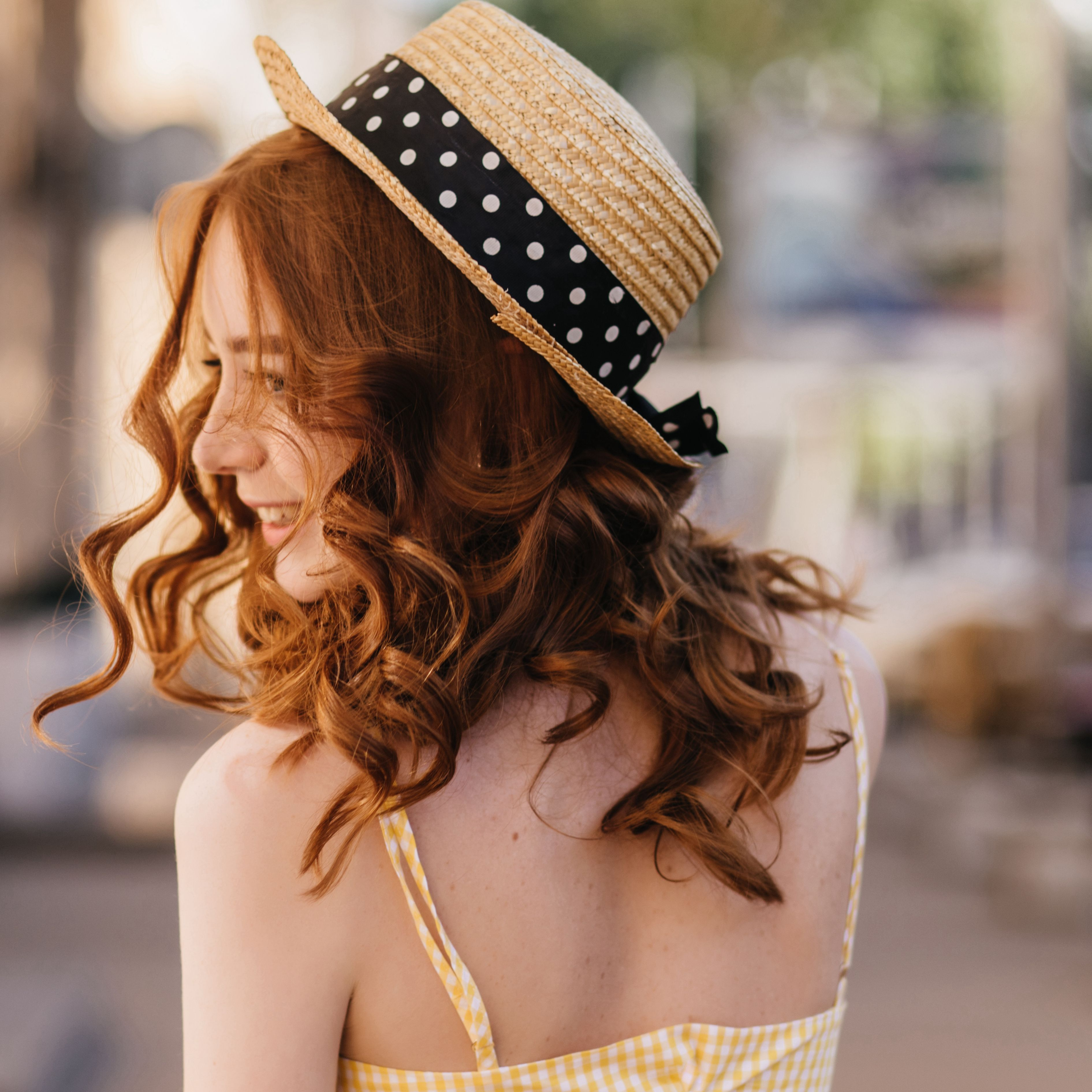 portrait-from-back-of-carefree-ginger-woman-in-hat-XBRKRYV.jpg